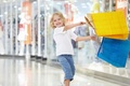 Picture girl, shopping, purchase, child, smile, laughter, blue, joy, happiness, packages, yellow