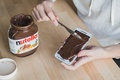 Picture Chocolate paste, Phone, Table, Knife, Nutella, Hands