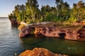 Picture the grotto, lake, the sky, rocks, trees, arch